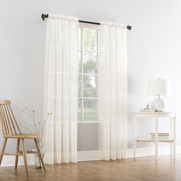 The white curtain panel