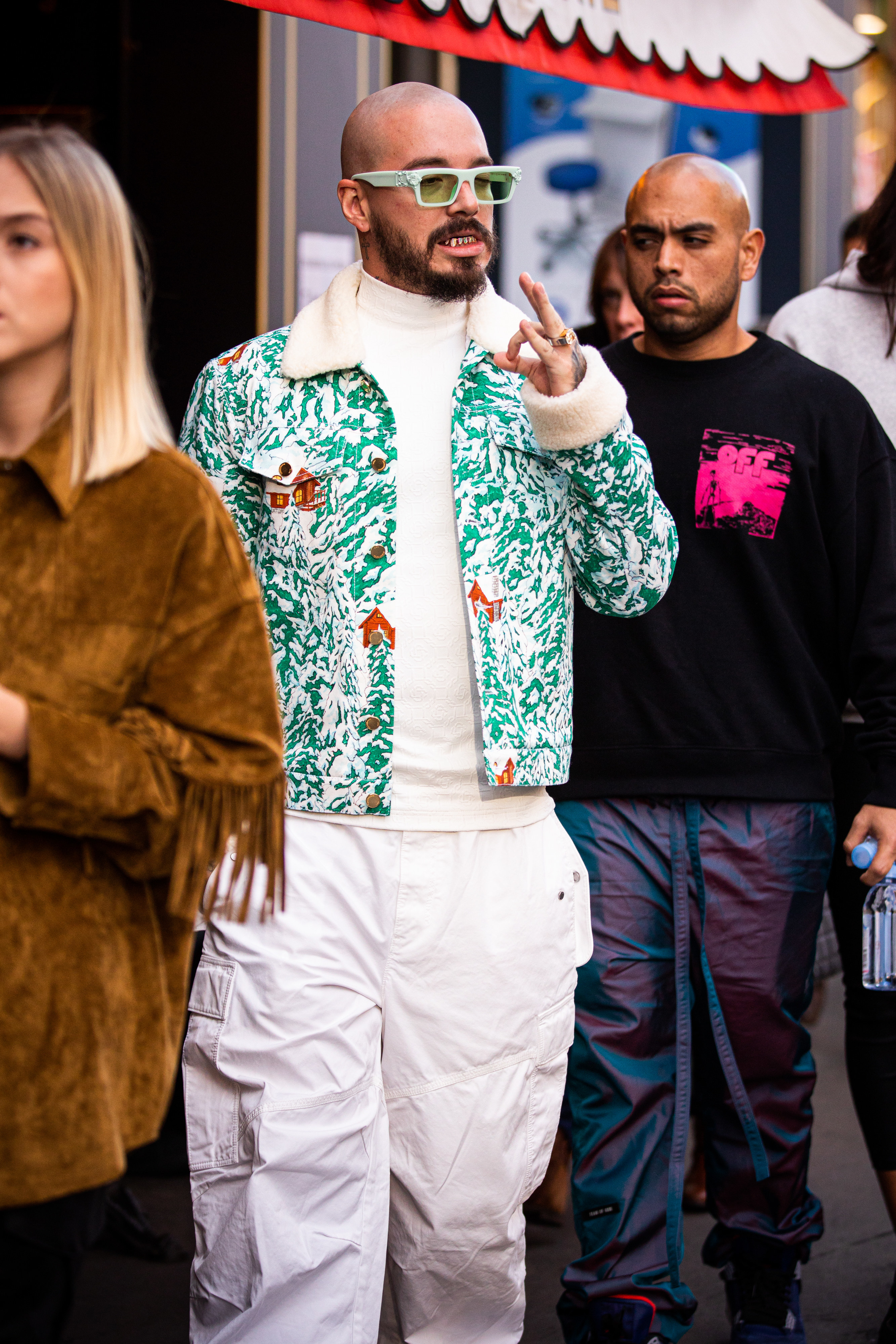 J Balvin, wearing a printed jacket, turtleneck sweater and pants, is seen outside the Casablanca show during Paris Fashion Week - Menswear F/W 2020-2021