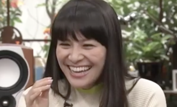 A Japanese woman laughs