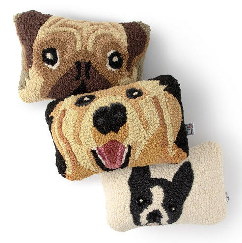 Three cushions with the faces of a pug, french bulldog and golden retriever on them
