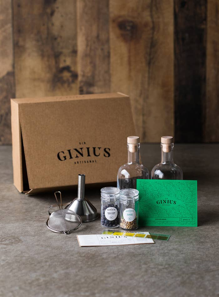 strainer, box, funnel, bottles, and botanicals