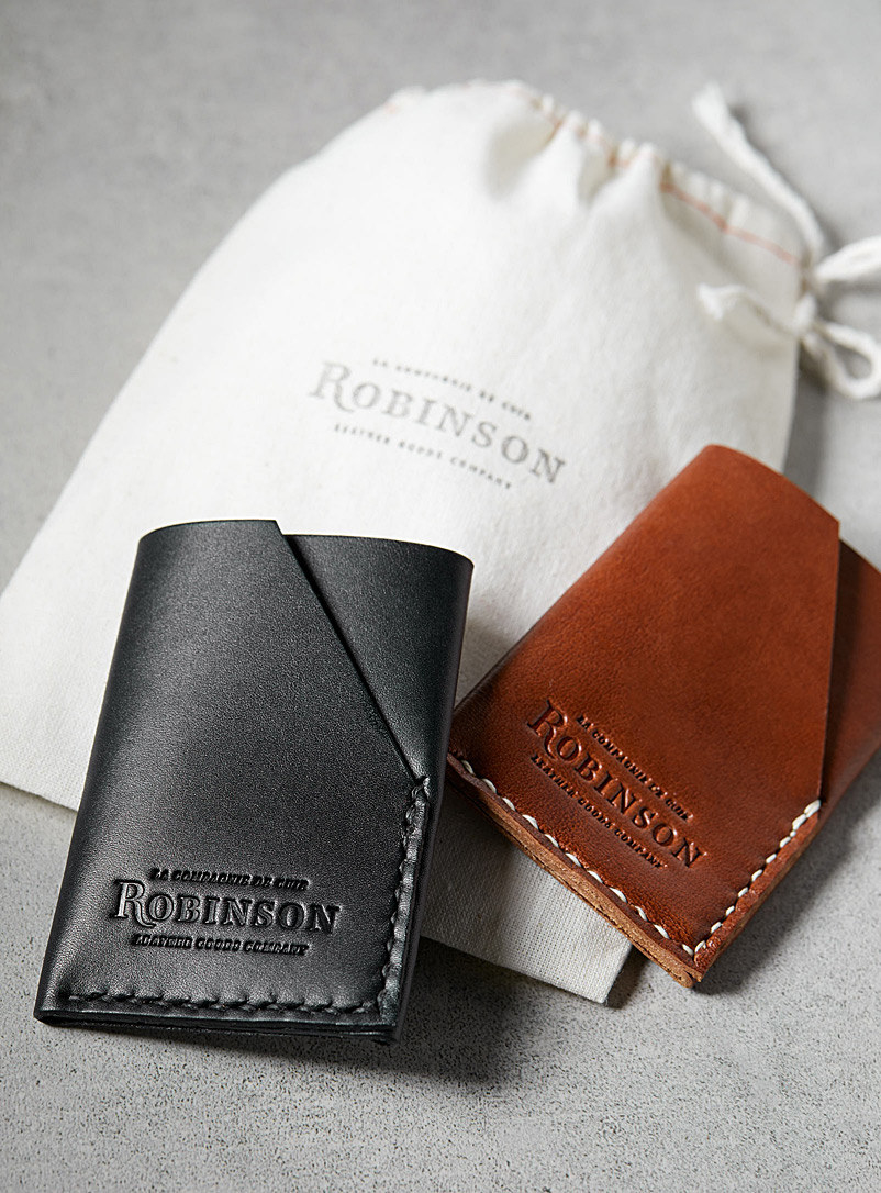 black and brown leather wallets