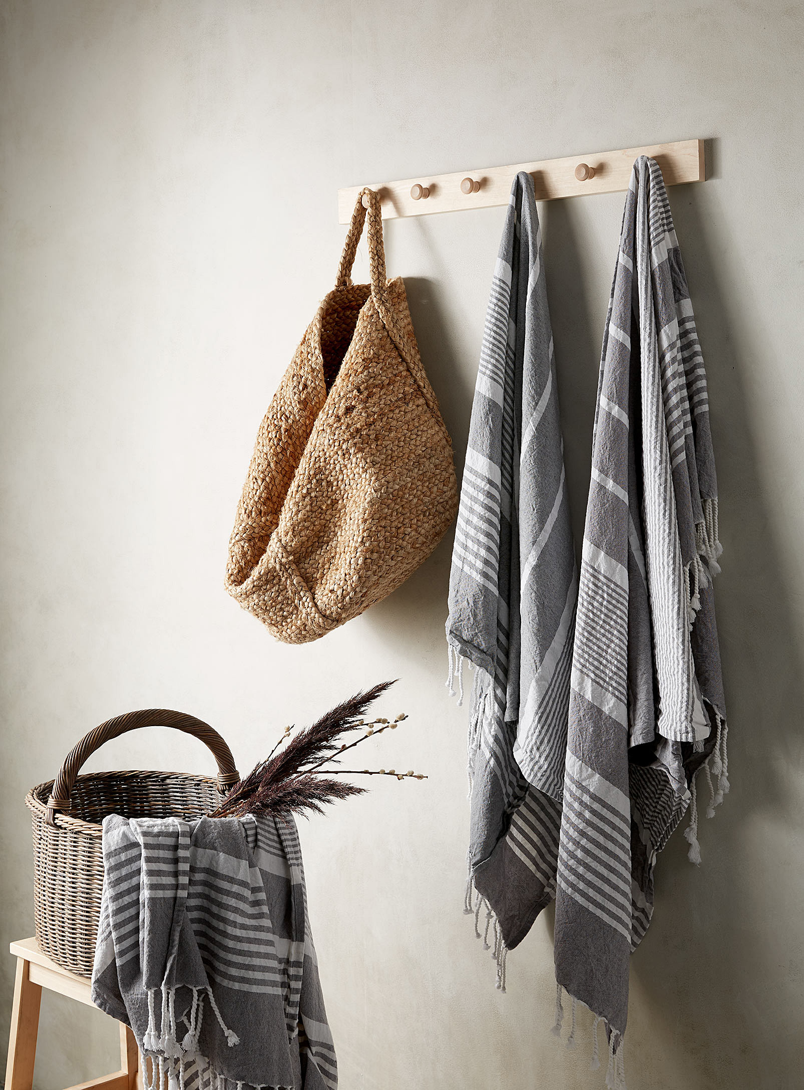 the towels hanging from a hook and out of a basket