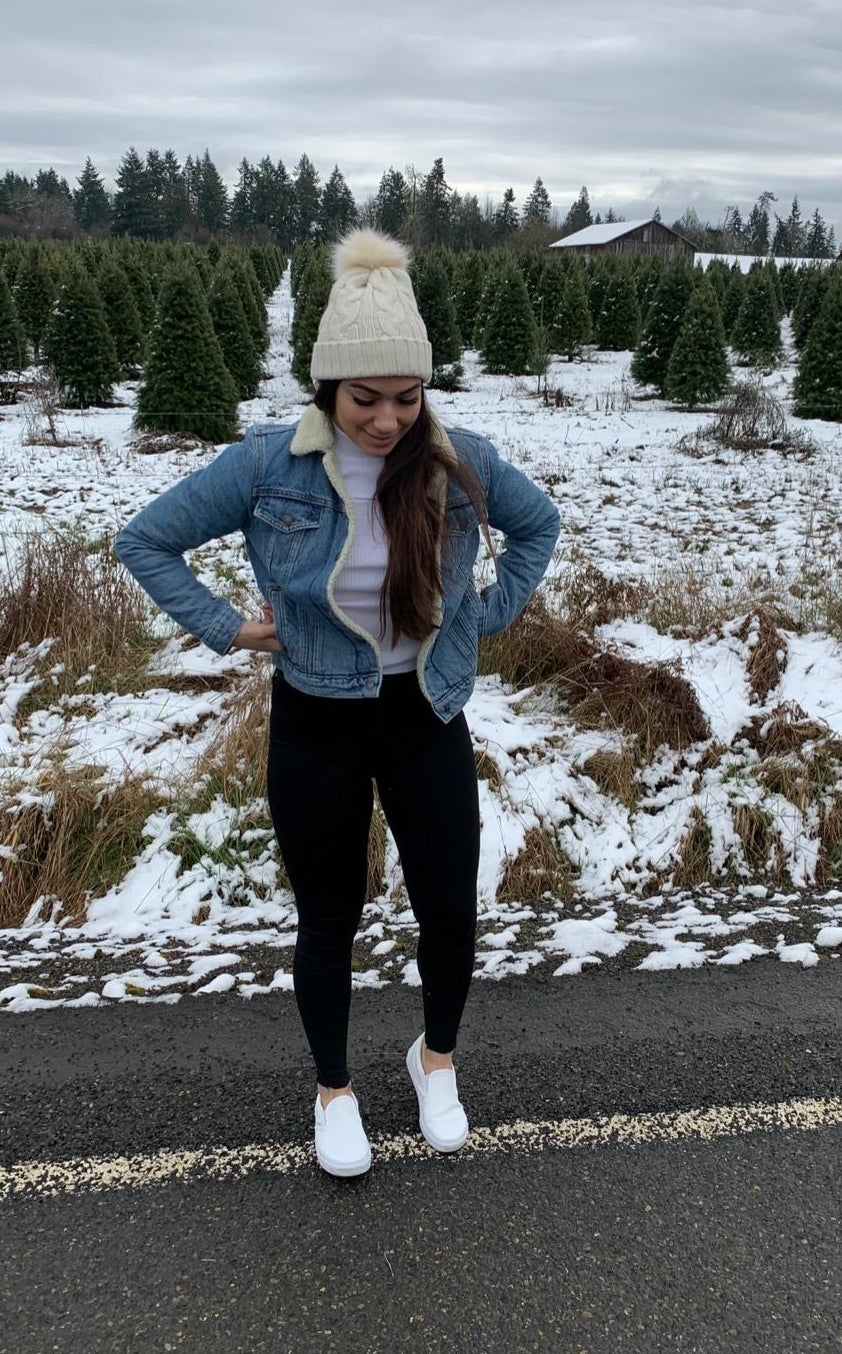 Reviewer wearing the jacket in light blue denim with white sherpa in the inside and on the collar