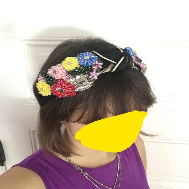 Reviewer wearing the black headband, showing how it looks on a head
