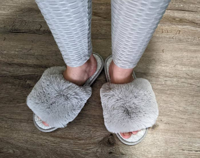 Reviewer wearing the fuzzy slipper slide with open toes