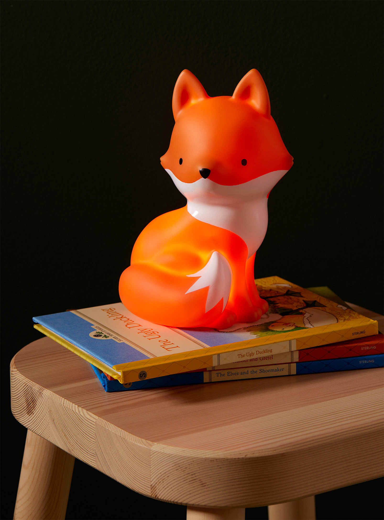 fox nightlight on a stack of books