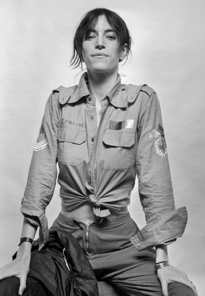 Patti Smith wearing a US Air Force shirtin a black and white photograph, mid-70s