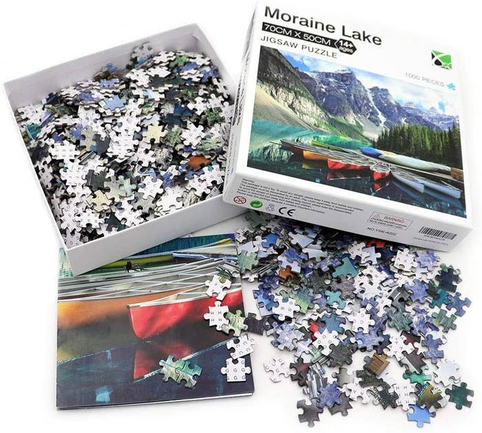 the agirlgle moraine lake puzzle, its pieces, and a folded poster