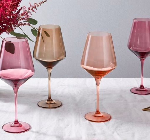 four wine glasses in various shades of pink by Estelle Colored Glass