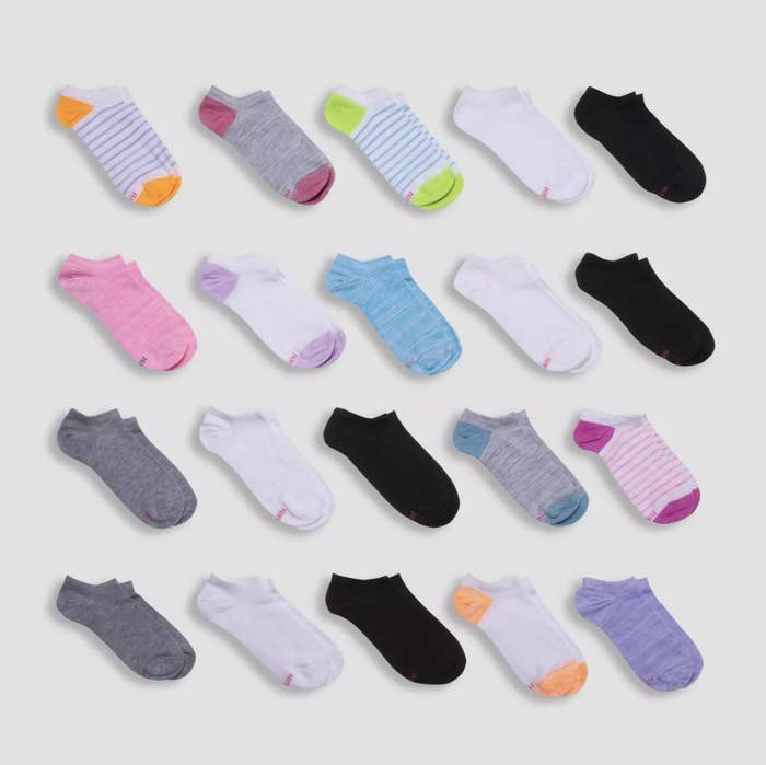 Twenty pairs of socks in various colors and patterns