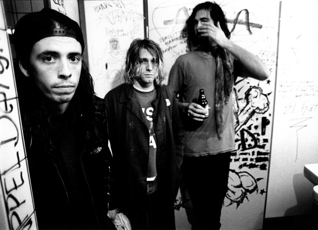 Nirvana posing for a group shot in a bathroom in 1991
