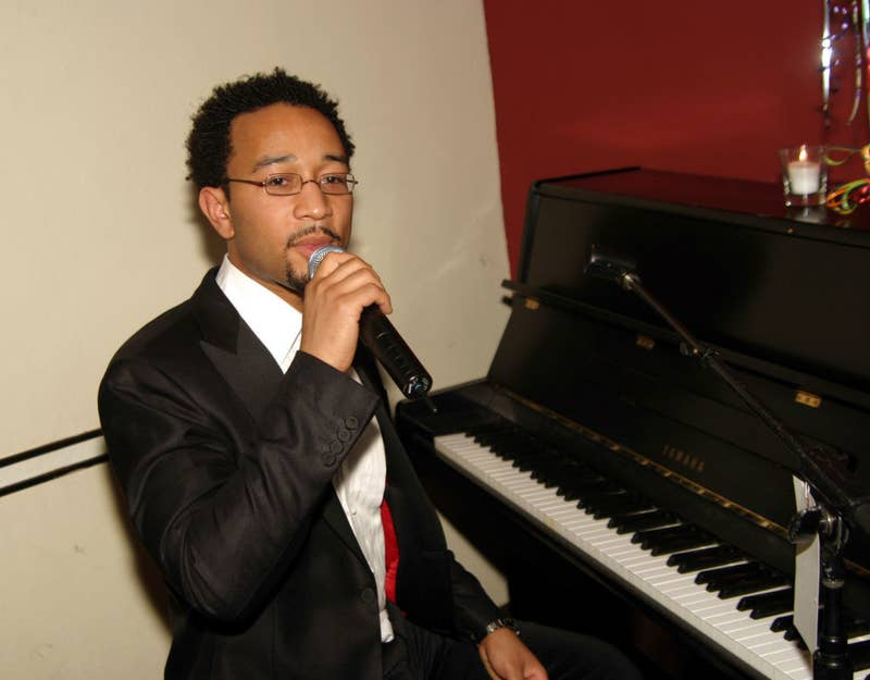 John Legend singing and playing piano at his birthday dinner in 2004
