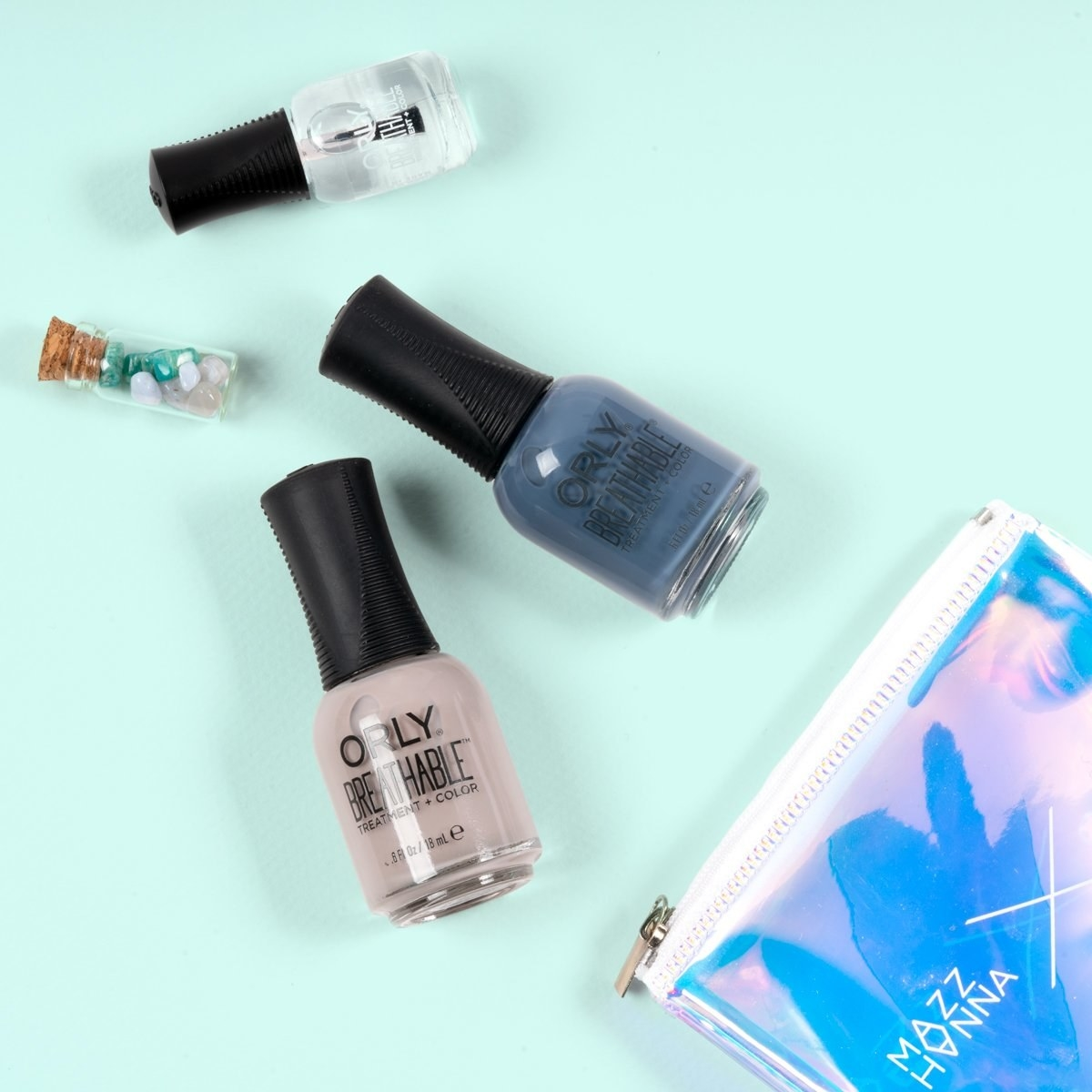 the small vial of crystals, two polishes, and a bottle of nail treatment