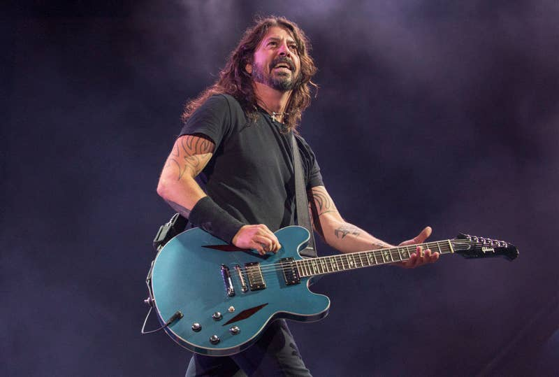 Dave Grohl performing with the Foo Fighters in 2018, playing guitar