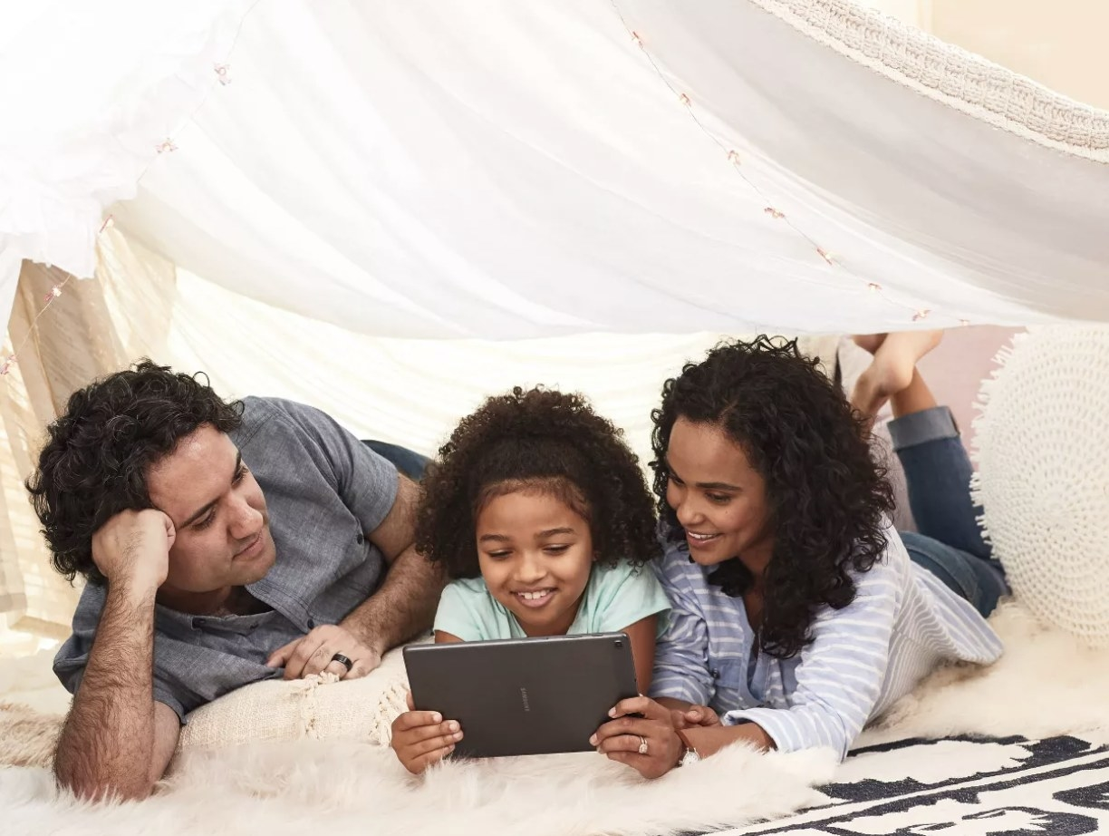 A family looking at a tablet