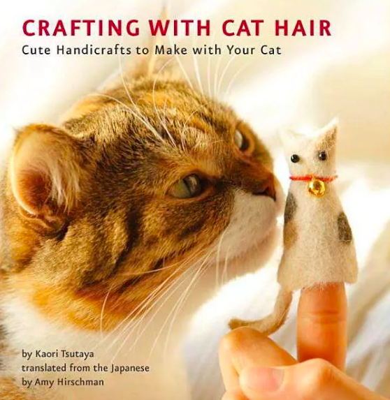 Book cover with photograph of cat smelling a finger puppet made of its fur
