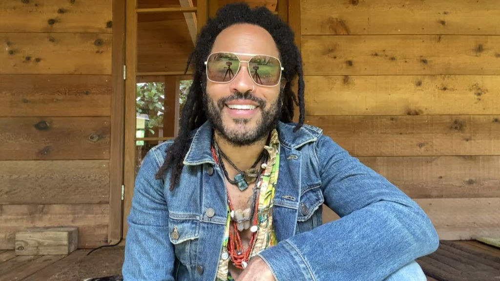 "Lenny Kravitz posing in a jean jacket at his house while on ""Watch What Happens Live with Andy Cohen"""