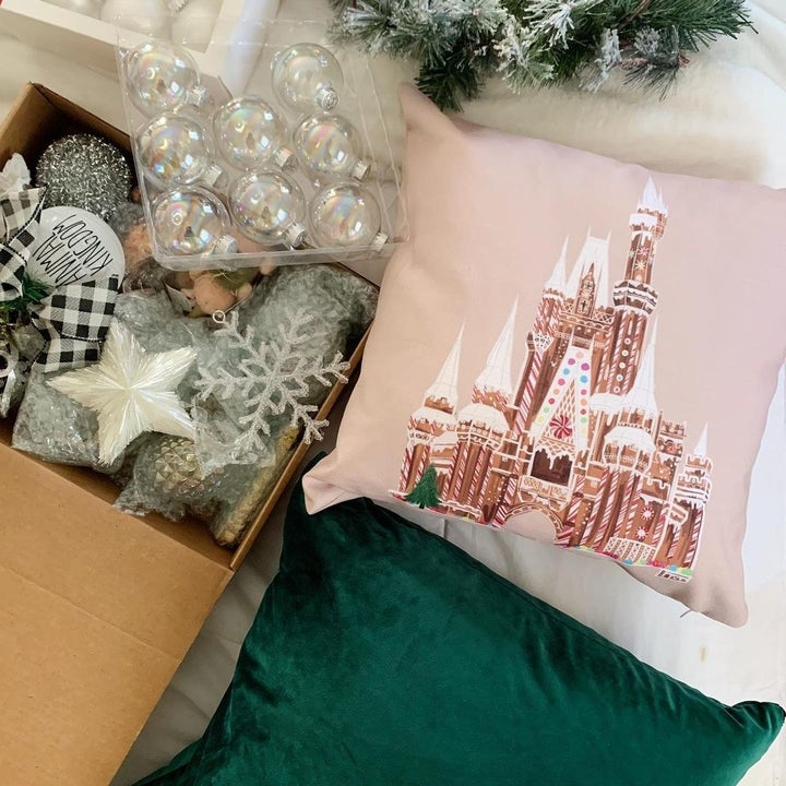 the design on a pillow next to a box of ornaments