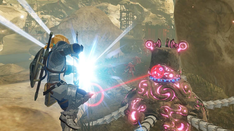 Link shoots an arrow at a machine beast