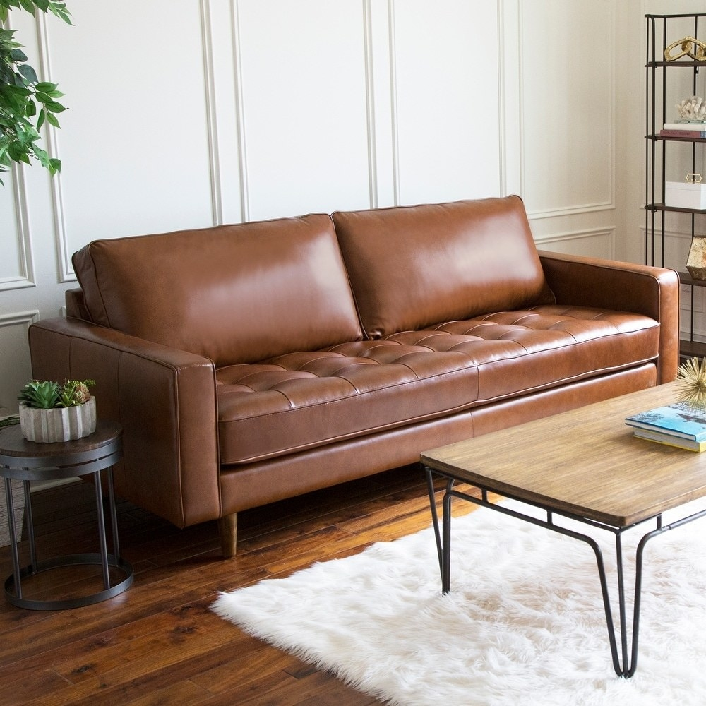The tufted leather couch in camel