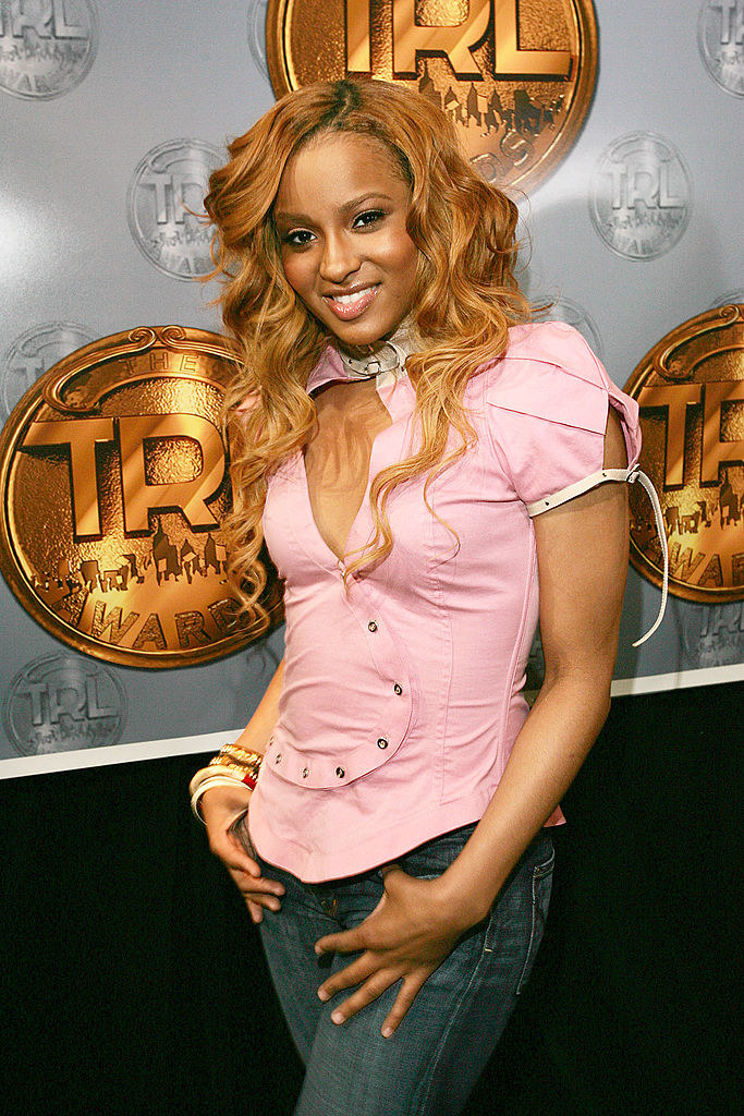 Ciara posing on a red carpet at the 2004 TRL awards