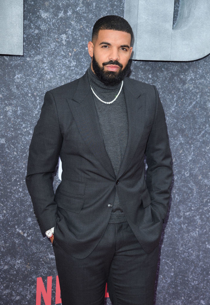 "Drake posing on a red carpet at the ""Top Boy"" premiere in 2019"