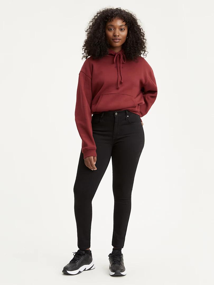 model wears black skinny jeans