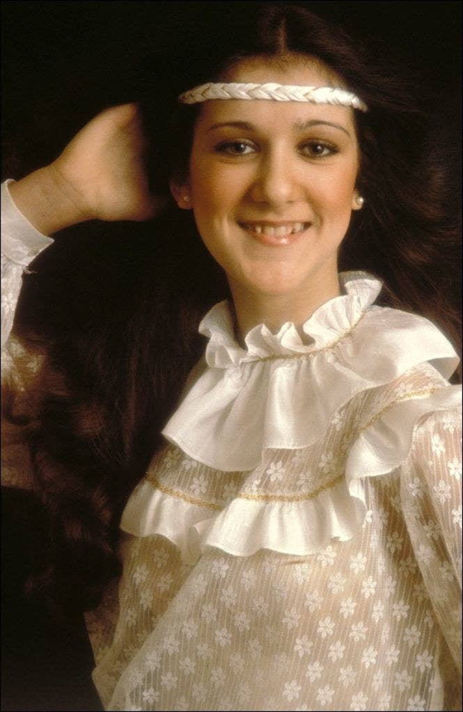 Celine Dion posing for a portrait in the 1980s, wearing a headband and long, brown hair