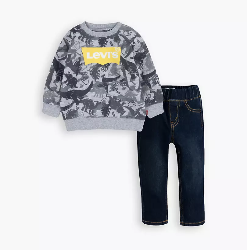 small sweater with dinosaur print and levi's logo next to small elastic waist jeans