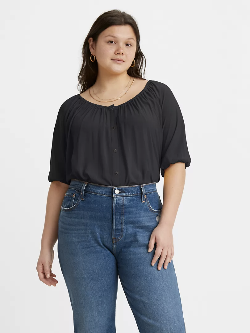 model wears button down short sleeve blouse with scoop neck