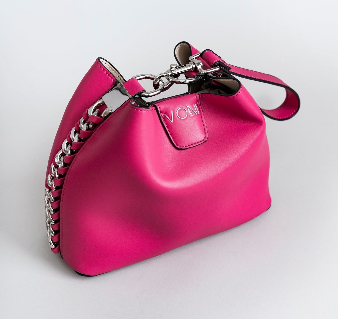 A pink and silver chain trimmed purse