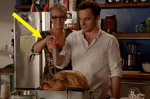 Nick and Jess's mom basting a turkey together