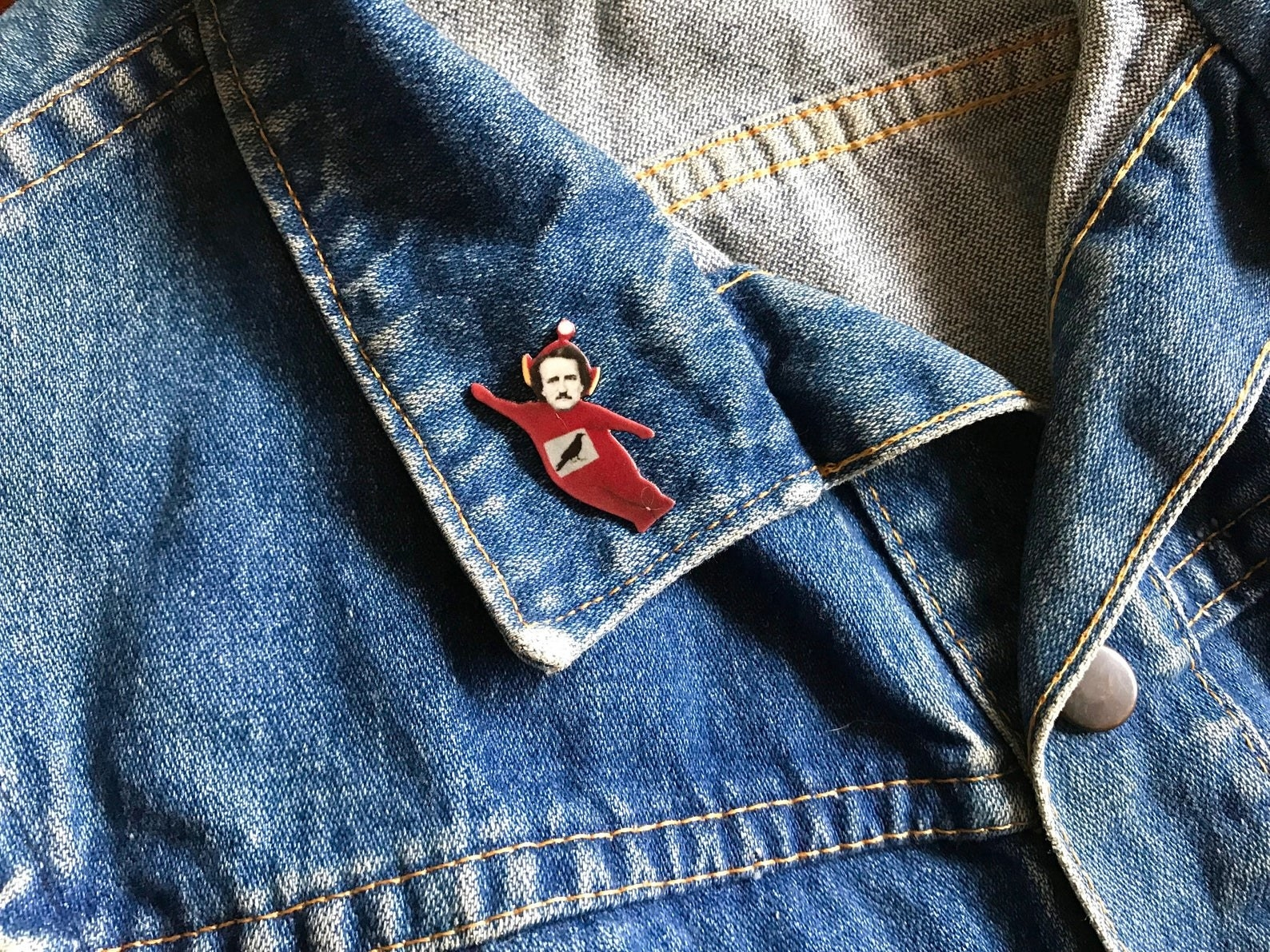 the red enamel pin
