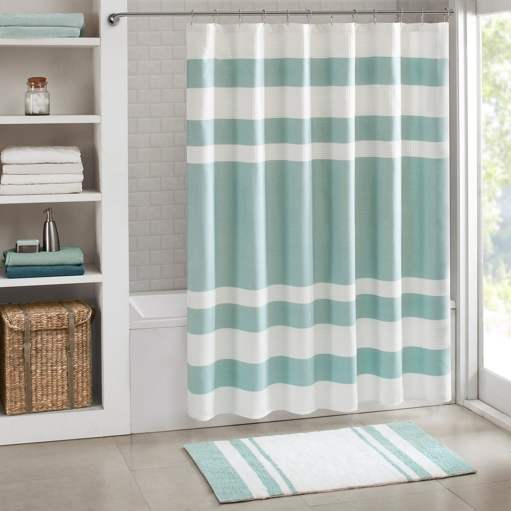The shower curtain in aqua