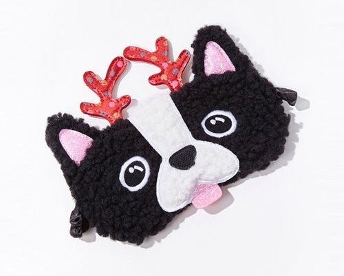 A faux shearling sleep mask featuring a Boston terrier puppy design with polka dot antlers, satin lining, and an elasticized head strap
