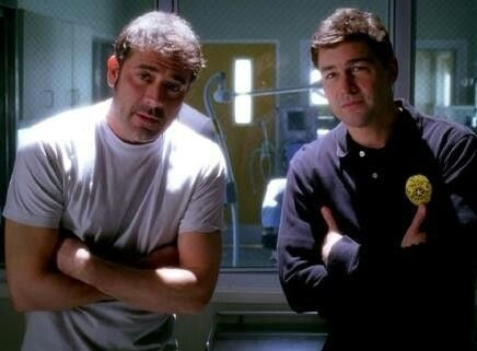 Dylan and Denny standing in front of Meredith on Grey's Anatomy