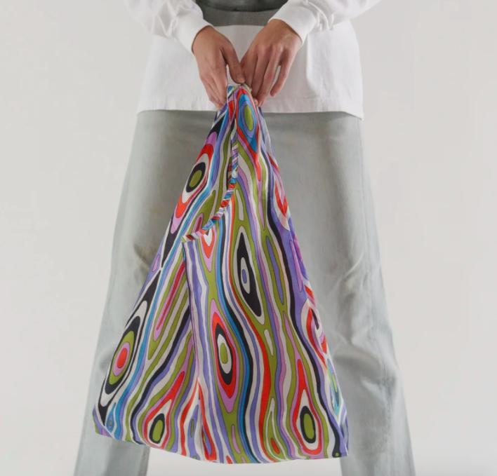 a model hold a baggu in the woodgrain style
