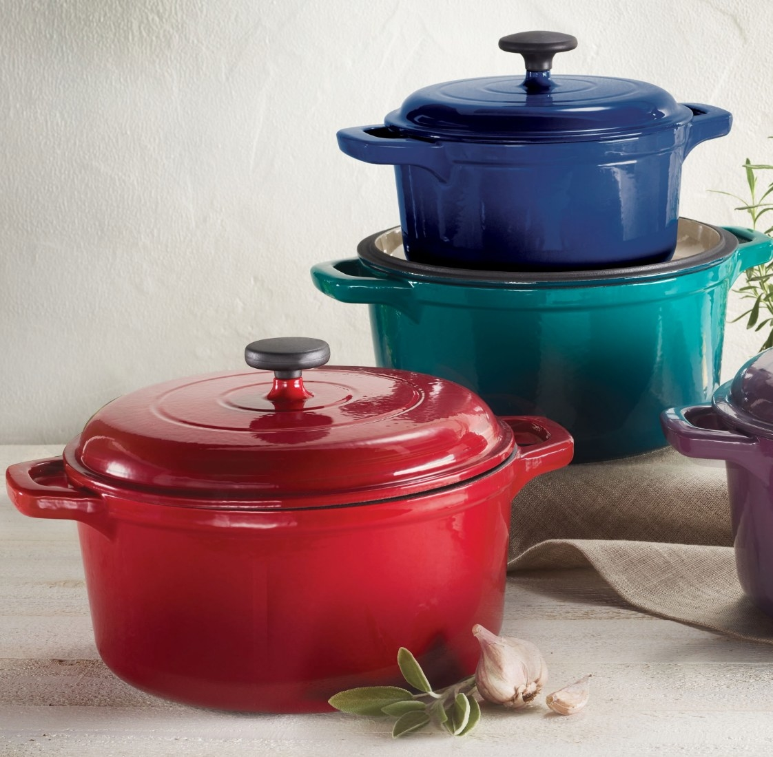 The enamel cast iron dutch ovens in three different colors