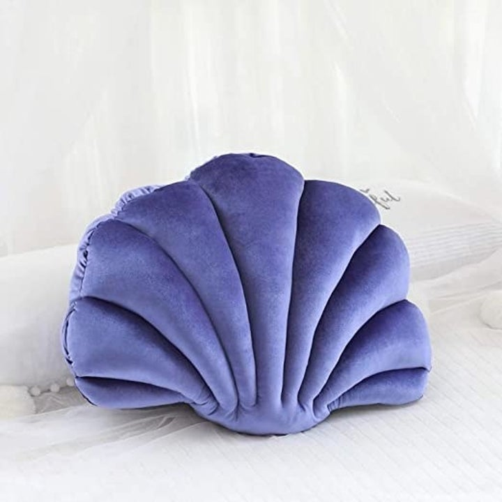 the purple version of the seashell pillow