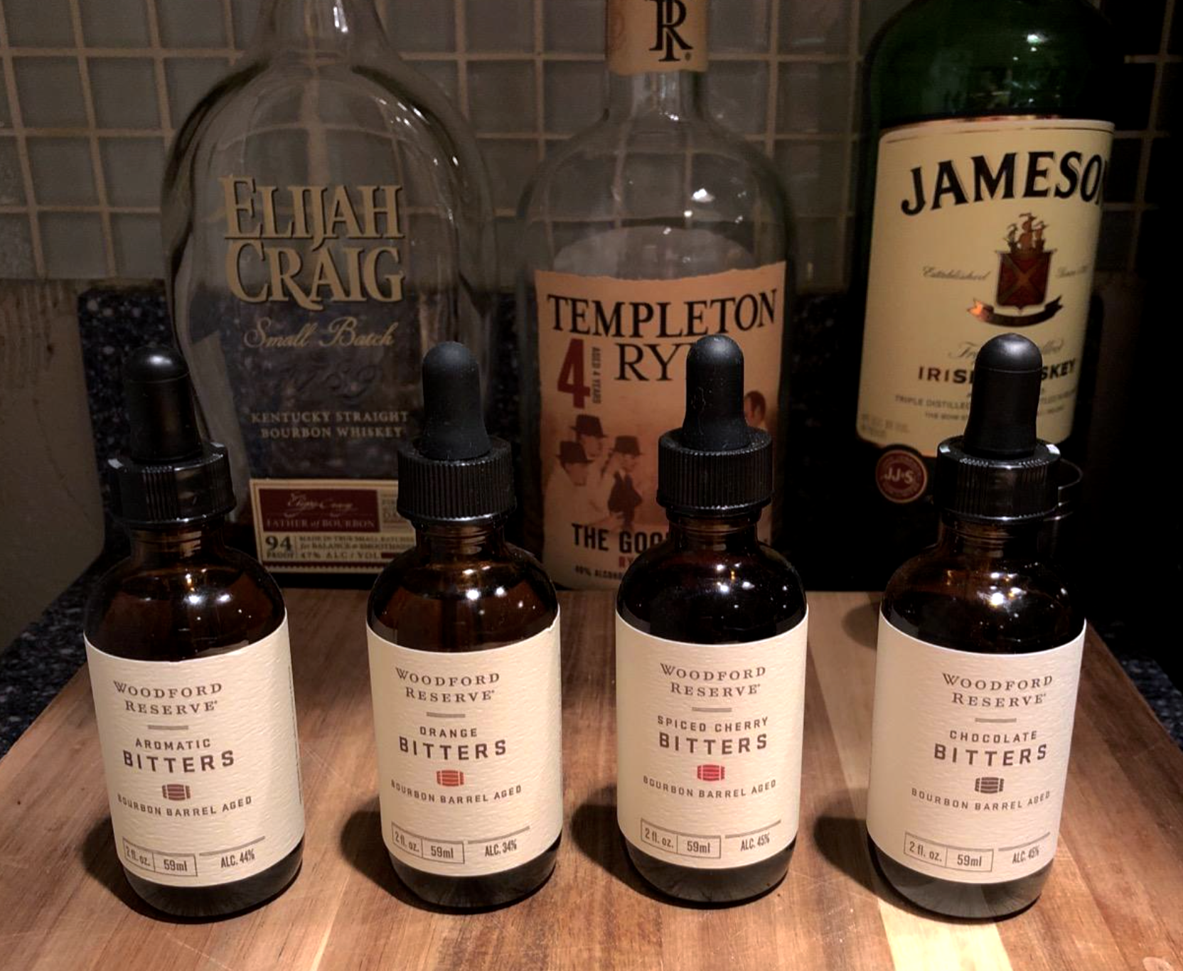 reviewer image of bitters laid out next to bottles of whiskey