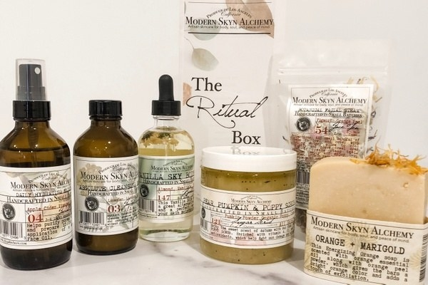 a hydrating elixir, handmade soap bar, cleansing wash, and other beauty items