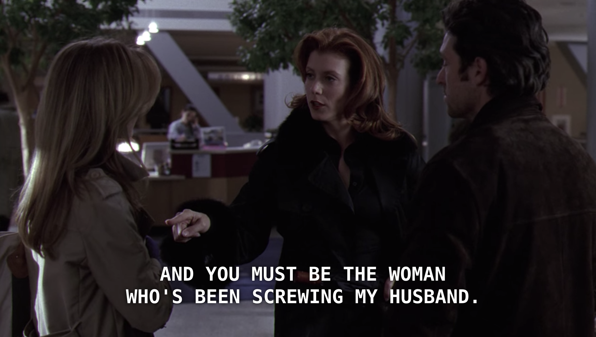 Addison confronting Meredith in the hospital lobby