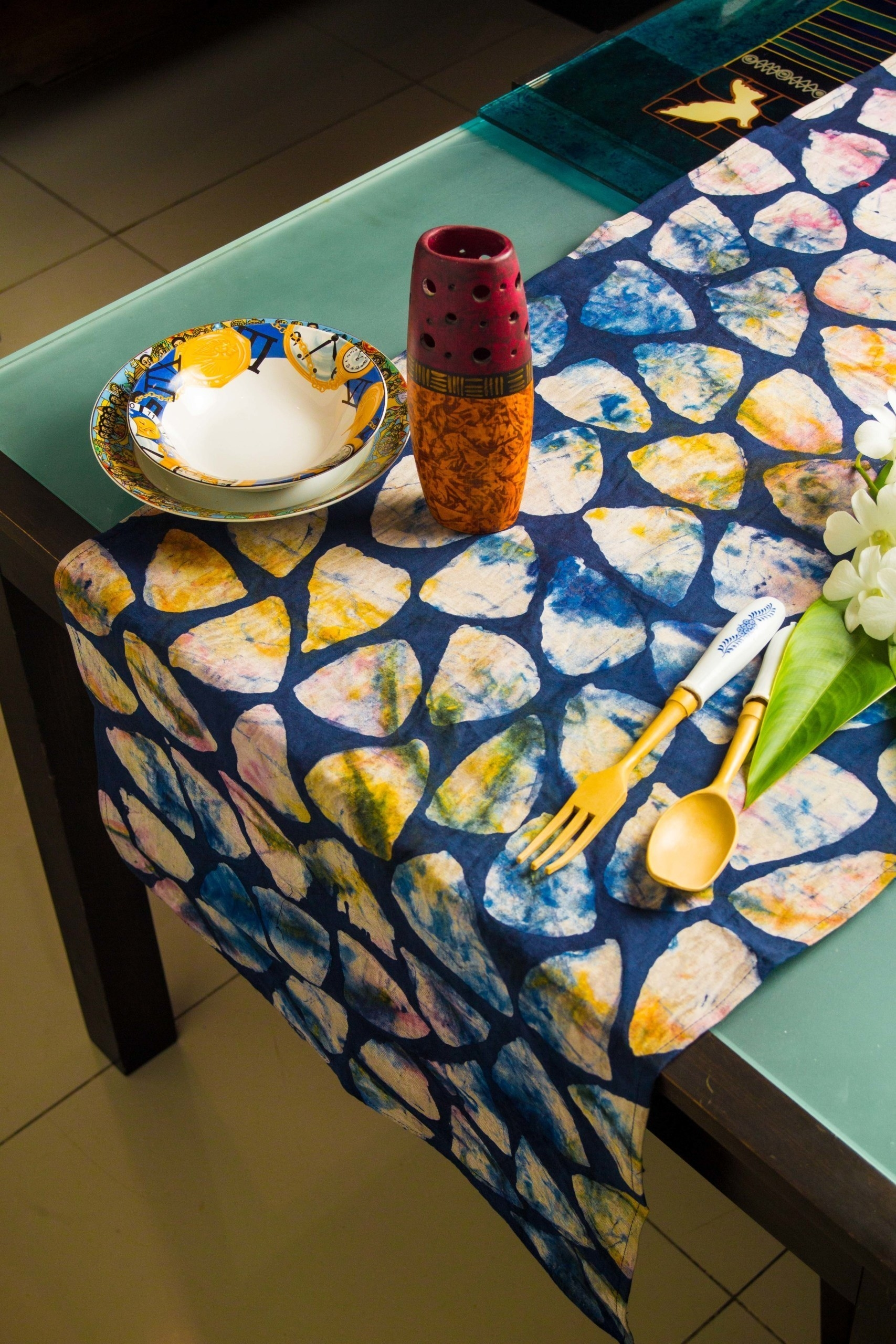 table with blue, colorful table runner on it