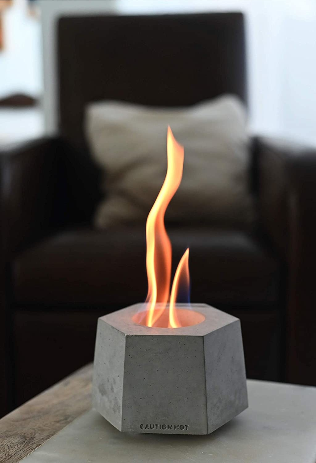 concrete planter-like fireplace on a table
