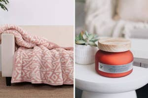 to the left: a pink aztec print blanket, to the right: an orange candle