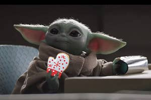 Baby Yoda holding a sugar cookie