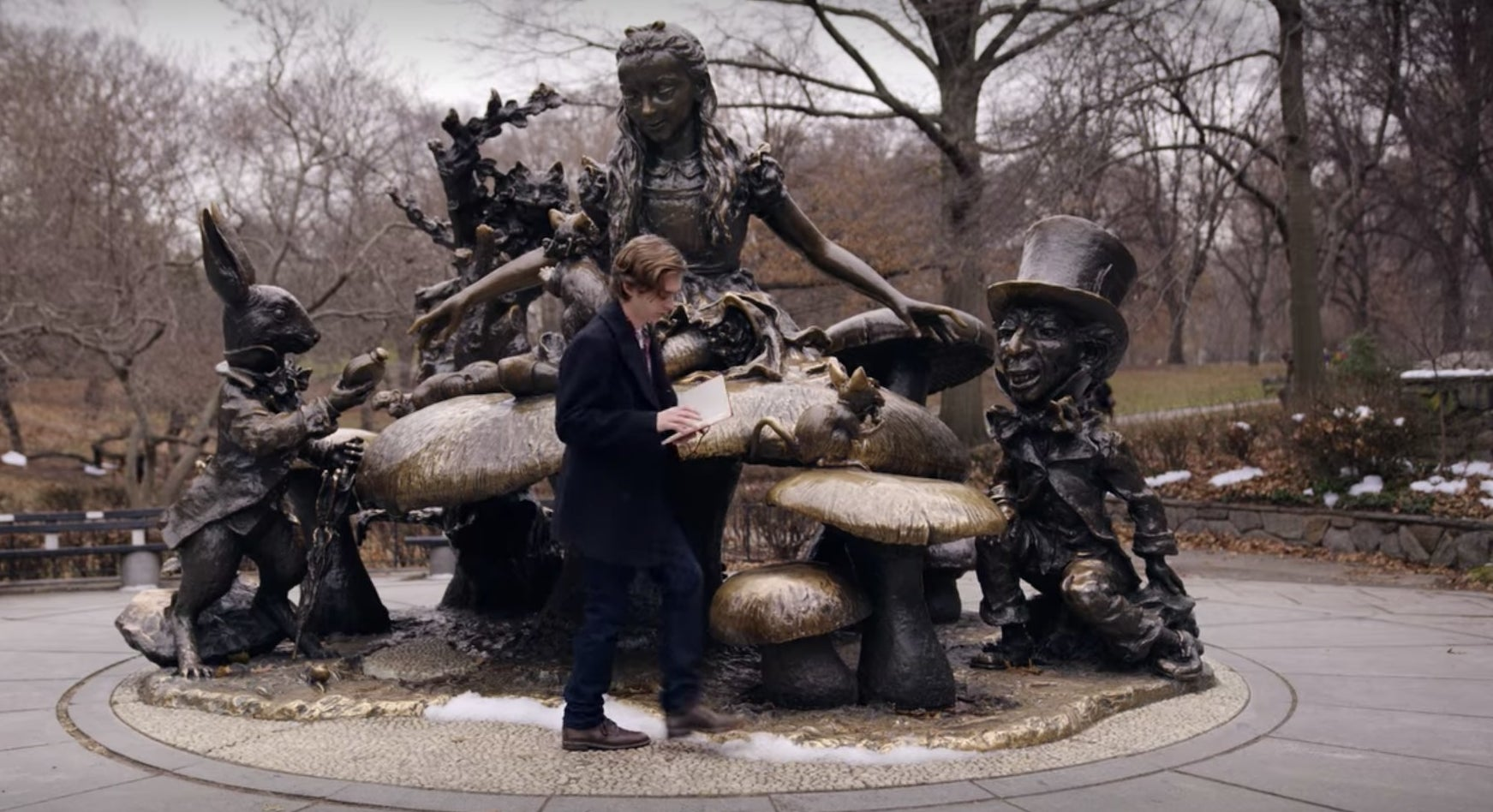 Dash stands in front of the Alice in Wonderland sculpture