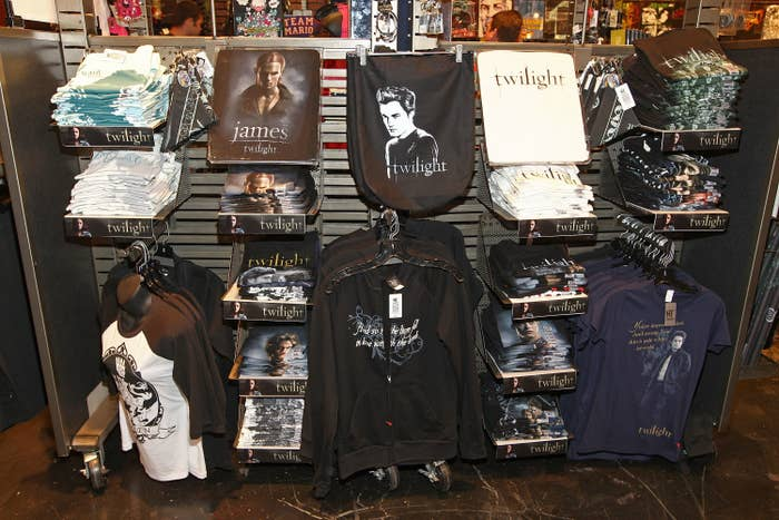 The inside of a Hot Topic store with a display shelf full of Twilight merchandise