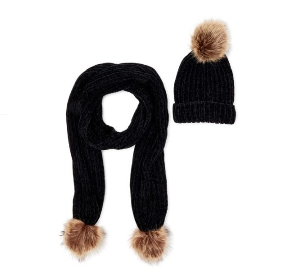 A hat and scarf with pom poms